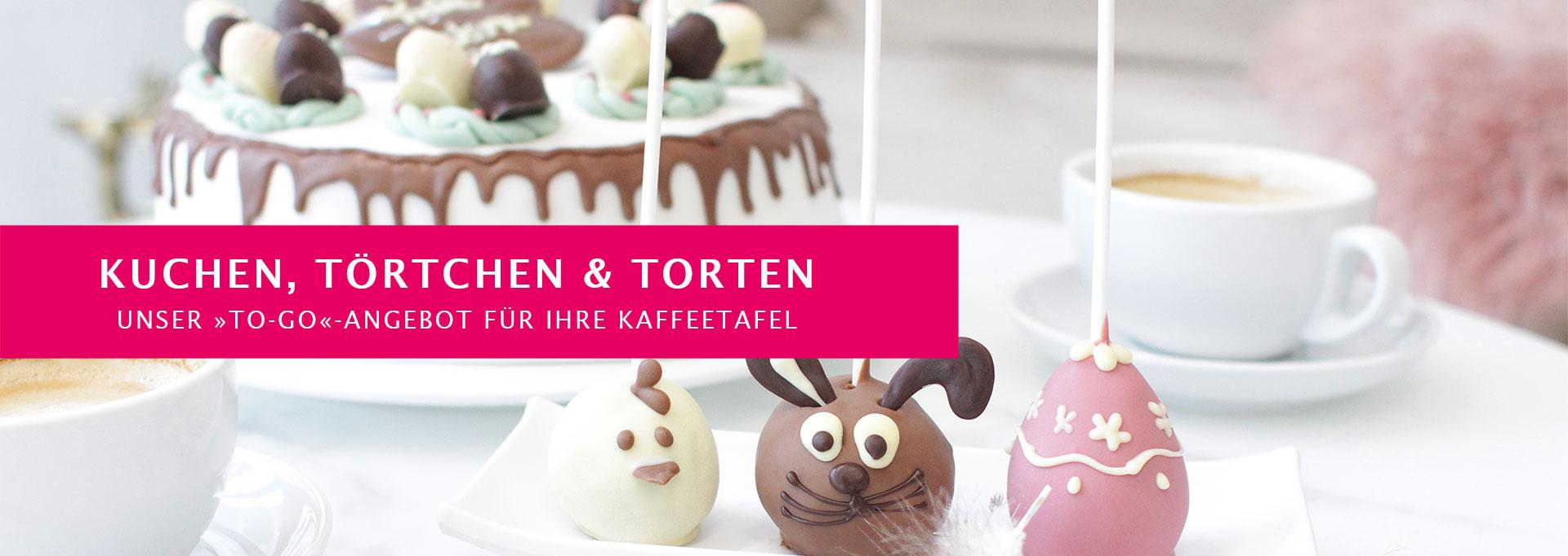 Kafeetafel mit Oster-Kuchen und Cake-Pops